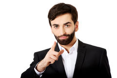 Happy businessman points his finger on you. Stock Images