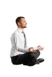 Happy businessman practicing yoga Stock Images