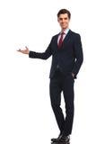 Happy businessman presenting something Royalty Free Stock Photo