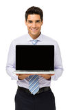 Happy Businessman Promoting Laptop Stock Image