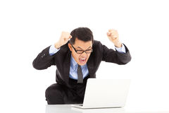 Happy businessman raise his hands to yell. On white background Royalty Free Stock Images