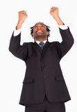 Happy businessman with raised arms. Happy afro-american businessman with raised arms looking upwards Royalty Free Stock Image
