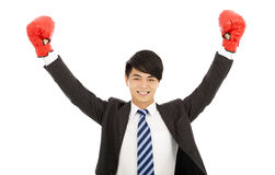 Happy businessman raises hands with gloves Stock Photos