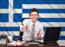Happy businessman reaches out Stock Images