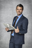 Happy businessman reading a newspaper Royalty Free Stock Image