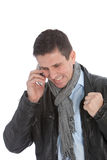 Happy Businessman Received a Good News on Phone. Close up Happy Handsome Businessman, in Black Jacket with Gray Scarf, Received a Good News through Mobile Phone Royalty Free Stock Photo