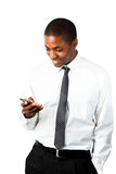 Happy businessman receiving a message via mobile royalty free stock photos
