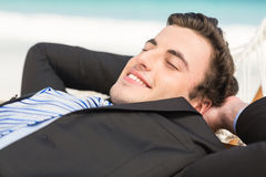 Happy businessman relaxing on the hammock Stock Photo