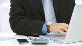 Happy businessman resting. In a front of computer stock footage