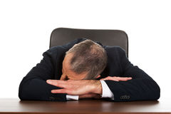 Happy businessman resting at his desk Stock Photo