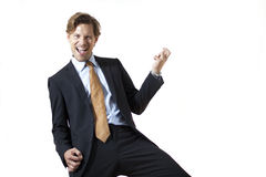 Happy businessman rocking it stock photography