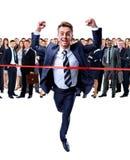 Happy businessman running through Royalty Free Stock Photos