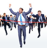Happy businessman running through finishing line Royalty Free Stock Photos
