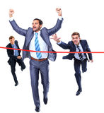 Happy businessman running through finishing Stock Photo