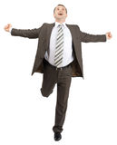 Happy businessman running forward Stock Photography
