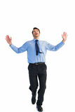 Happy businessman running with hands up Royalty Free Stock Image