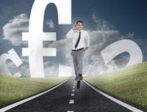 Happy businessman running on a road with euro currency Stock Photo