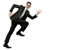 Happy businessman runs in black suit on white. Stock Photography