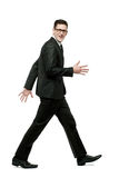 Happy businessman runs in black suit on white. Royalty Free Stock Images