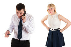 Happy businessman and sad wife Royalty Free Stock Photos