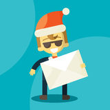 Happy businessman in Santa Claus hat. Letter Stock Photography