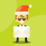 Happy businessman in Santa Claus hat. Letter with Royalty Free Stock Photography