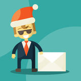 Happy businessman in Santa Claus hat. Letter with Royalty Free Stock Photos