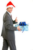 Happy businessman in Santa Hat holding present Stock Photography