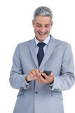 Happy businessman sending text message Royalty Free Stock Photography