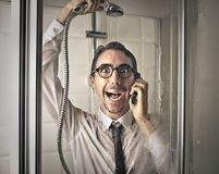 Happy businessman in the shower Royalty Free Stock Photo