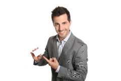 Happy businessman showing a blank card with finger Royalty Free Stock Images