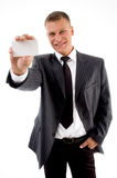 Happy businessman showing business card. On an isolated white background Royalty Free Stock Photography