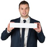 Happy businessman showing card to camera Stock Image