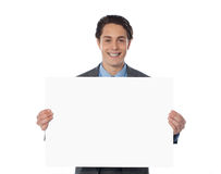 Happy businessman showing an emty billboard Royalty Free Stock Photos