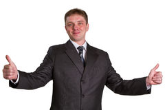 Happy businessman showing his thumbs up. With smile over white background Stock Photography