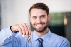 Happy businessman showing house keys Stock Image