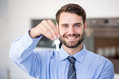 Happy businessman showing house keys Royalty Free Stock Photo