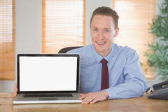 Happy businessman showing laptop screen. In his office royalty free stock photos
