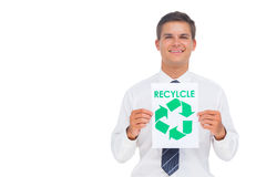 Happy businessman showing a paper with environmental awareness s Stock Photography