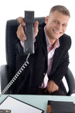 Happy businessman showing receiver Royalty Free Stock Photos