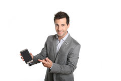 Happy businessman showing screen of smartphone with finger Royalty Free Stock Image