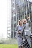 Happy businessman showing something to businesswoman in city Royalty Free Stock Photography