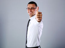 Happy businessman showing thumb up Stock Photo