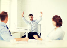 Happy businessman showing thumbs up in office Royalty Free Stock Photo