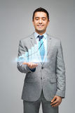 Happy businessman showing virtual chart projection Royalty Free Stock Image