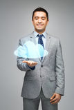Happy businessman showing virtual cloud projection Royalty Free Stock Photography
