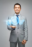 Happy businessman showing virtual projection Royalty Free Stock Photography