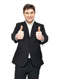Happy businessman shows thumbs up Royalty Free Stock Photography