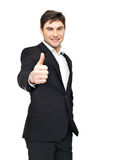 Happy businessman shows thumbs up Stock Image