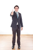 Happy businessman shows thumbs up Stock Images